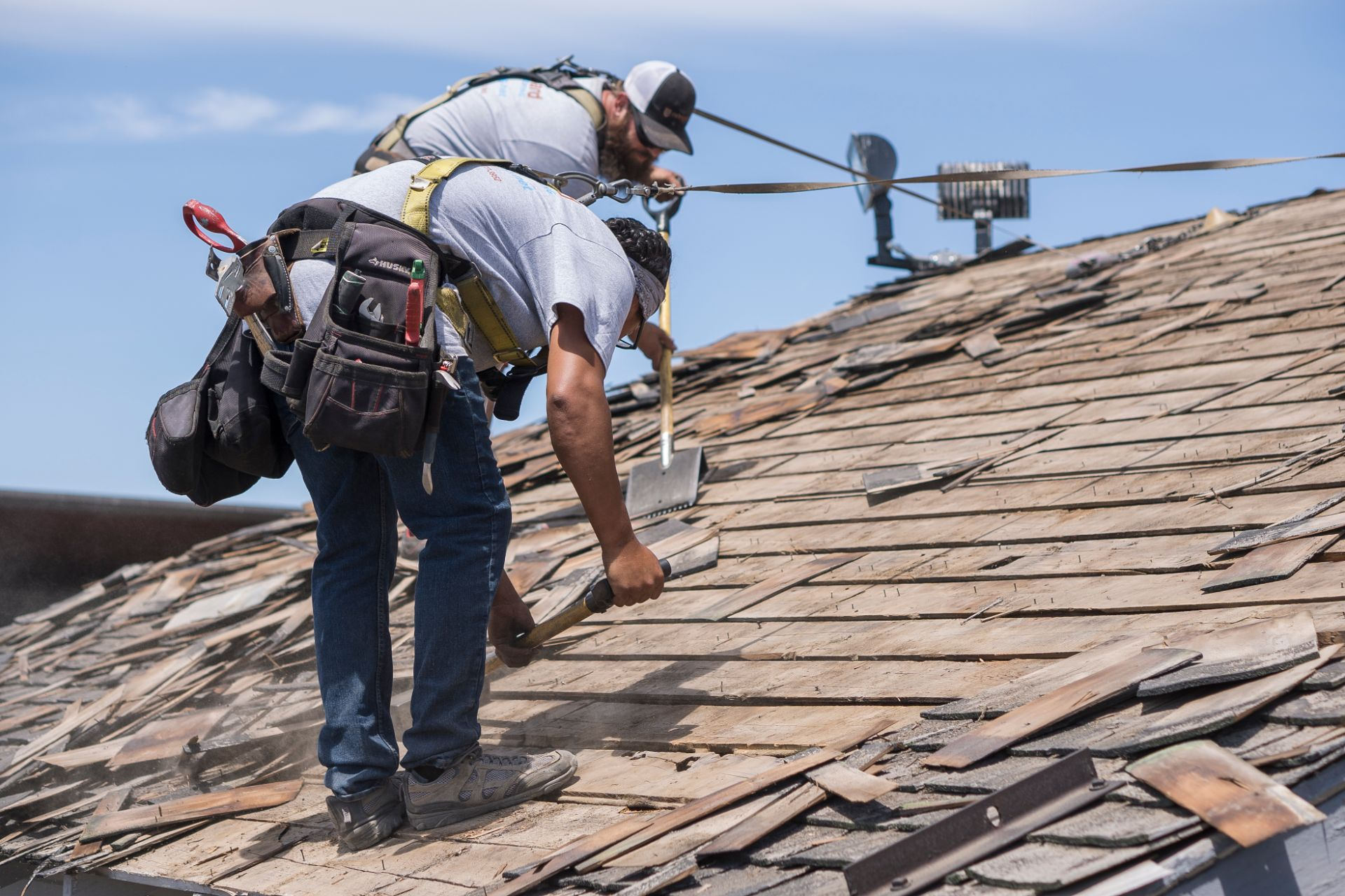 roofer performing a roof repair